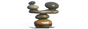 carefully balance stones in water