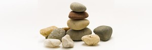 stones piles on centered stack with various colored and sized stones surrounding it